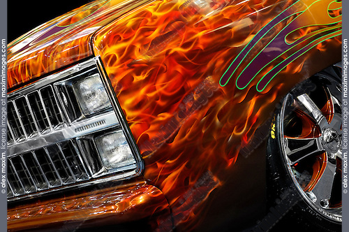 Hot Rod Chevrolet Scotsdale 1978 retro pickup truck with flame pattern painted on it closeup