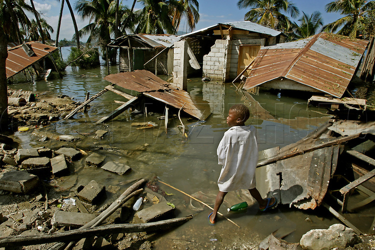 Earthquake aftermath in Haiti on Monday, January 25, 2010..The shoreline in the city of Petit Goave changed when the fault line shifted surrounding these homes with ocean water after the earthquake. Joseph Lawson, 11, ran out of his shack. His father broke his leg trying to get out.
