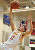 Michael O'Connell #12 soars through the air for a lay up during the NSCHSAA varsity boys basketball final against St. Anthony's at Hofstra University on Tuesday, Feb. 27, 2018. St. Anthony's won by a score of 63-60.
