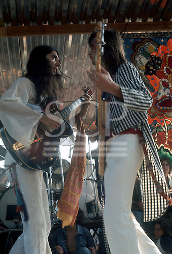 Sao Paulo, Brazil. Sergio Dias and Liminha, Mutantes on stage performing at the Som Encontrante show, Ibirapuera Park, Sao Paulo, December 1973.