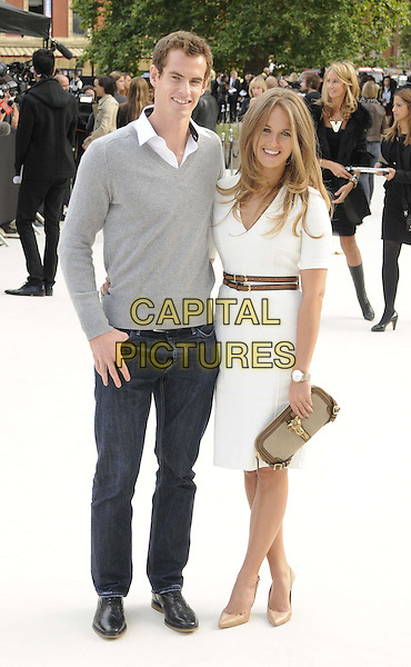 Andy Murray & Kim Sears.Burberry Prorsum Spring/Summer 2013 Womenswear Fashion Show, London Fashion Week LFW, Kensington Gardens, London, England..17th September 2012.full length dress brown belt beige clutch bag couple shoes white shirt collar grey gray jeans denim.CAP/CAN.©Can Nguyen/Capital Pictures.