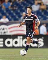 New England Revolution midfielder Ryan Guy (13) brings the ball forward. In a Major League Soccer (MLS) match, the New England Revolution defeated Columbus Crew, 2-0, at Gillette Stadium on September 5, 2012.