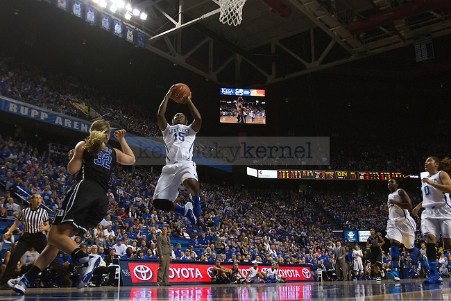 Kentucky Wildcats guard Linnae Harper (15) shoots the ball on a fast break during the first half of the University of Kentucky women's basketball game vs. Duke University at Rupp Arena in Lexington, Ky., on Sunday, December 22, 2013. Duke defeated Kentucky 69-61. Photo by Michael Reaves | Staff.