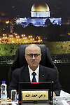 Palestinian Prime Minister Rami Hamdallah chairs a meeting with council of Ministers in the West Bank city of Ramallah on December 4, 2018. Photo by Prime Minister Office