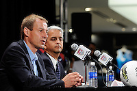 New US Men's National Team Head Coach Jurgen Klinsmann addresses the media as United States Soccer Federation President Sunil Gulati listens at a press conference at NIKETOWN in New York, NY, on August 01, 2011.