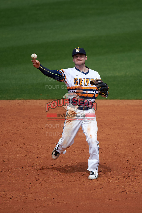 Canisius College Golden Griffins shortstop Anthony Massicci (7) throws to first base during the first game of a doubleheader against the Michigan Wolverines on February 20, 2016 at Tradition Field in St. Lucie, Florida.  Michigan defeated Canisius 6-2.  (Mike Janes/Four Seam Images)