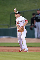Peoria Chiefs third baseman Michael Schulze (4) throws to first during a game against the Kane County Cougars on June 2, 2014 at Dozer Park in Peoria, Illinois.  Peoria defeated Kane County 5-3.  (Mike Janes/Four Seam Images)
