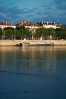 Lyon, France, river barge on the Rhone, and view of the city
