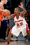 MADISON, WI - NOVEMBER 8: Guard Michael Flowers #22 of the Wisconsin Badgers plays defense against the Carroll College Pioneers at the Kohl Center on November 8, 2006 in Madison, Wisconsin. The Badgers beat the Pioneers 81-61. (Photo by David Stluka)