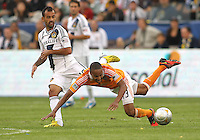 CARSON, CA - DECEMBER 01, 2012:   Juninho (19) of the Los Angeles Galaxy knocks the ball under Ricardo Clark (13) of the Houston Dynamo during the 2012 MLS Cup at the Home Depot Center, in Carson, California on December 01, 2012. The Galaxy won 3-1.
