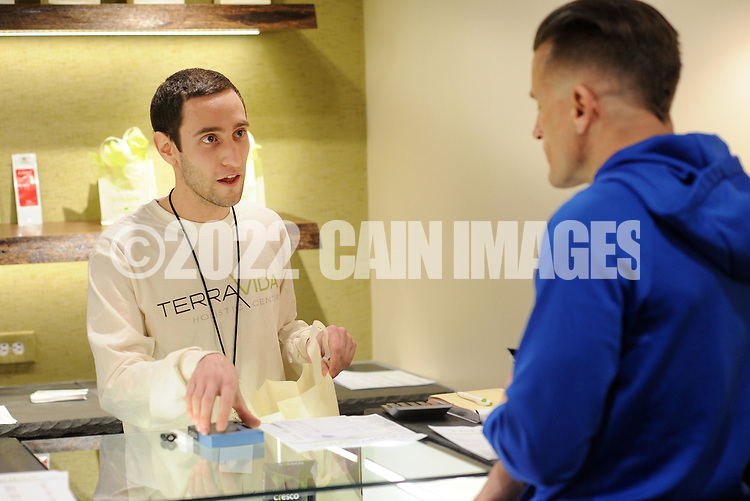Josh Reiss (left) helps patient Robert Consulmagno at TerraVida Holistic Center, which is one of the first medical marijuana dispensary's in Pennsylvania to open Saturday, February 17, 2018 in Sellersville, Pennsylvania. (WILLIAM THOMAS CAIN / For The Inquirer)