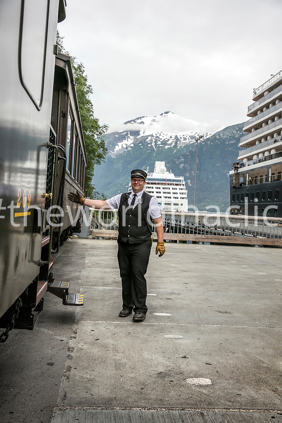 USA, Alaska, Sitka, one of the train conductors prepares to board the train, the White Pass & Yukon Route Railroad from the town of Sitka up and into Canada