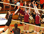 SIOUX FALLS, SD - OCTOBER 1: Rochelle Ramharter #3 from Washington tries to tip the ball past  Madison Tyler #3 and Elizabeth Fiegen #12 from Roosevelt in the fourth game of their match Tuesday night at Washington. (Photo by Dave Eggen/Inertia)