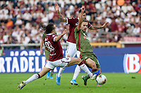 27th October 2019; Olympic Grande Torino Stadium, Turin, Piedmont, Italy; Serie A Football, Torino versus Cagliari; Diego Laxalt of Torino FC challenges Marko Rog of Cagliari - Editorial Use
