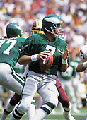 Philadelphia Eagles quarterback Ron Jaworski (7) looks to pass the ball during the game against the Washington Redskins at RFK Stadium in Washington, DC  on September 7, 1986.  The Redskins won the game 41 - 14.<br /> Credit: Arnie Sachs / CNP