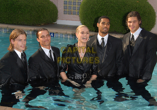 HEIDI KLUM.Falls in the swimming pool at The unveiling of her second collection of the Heidi Klum Collection for QVC in Beverly Hills, California, USA..April 6th, 2007.half length water wet black top funny suit.CAP/DVS.©Debbie VanStory/Capital Pictures