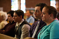 "From right, mother Christine Arnold (in blue), triplet sons Scott Arnold, Sean Arnold, and Christian Arnold (all 17), and their grandparents Joanmarie and Tom Gorman, all of Scituate, take part in the last service at St. Frances Xavier Cabrini Church in Scituate, Mass., on Sun., May 29, 2016. Members of the congregation have been holding a vigil for more than 11 years after the Archdiocese of Boston ordered the parish closed in 2004. For 4234 days, at least one member of Friends of St. Frances X. Cabrini has been at the church at all times, preventing the closure of the church. May 29, 2016, was the last service held at the church after members finally agreed to leave the building after the US Supreme Court decided not to hear their appeal to earlier an Massachusetts court ruling stating that they must leave. The last service was called a ""transitional mass"" and was the first sanctioned mass performed at the church since the vigil began."