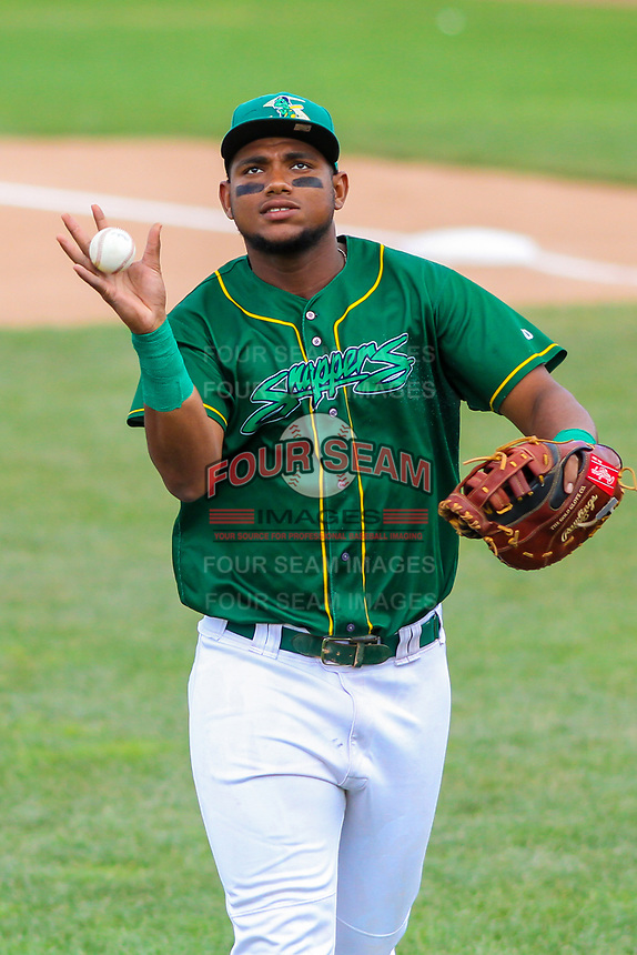 Beloit Snappers first baseman Miguel Mercedes (7) catches a ball as he heads into the dugout between innings during a Midwest League game against the Quad Cities River Bandits on June 18, 2017 at Pohlman Field in Beloit, Wisconsin.  Quad Cities defeated Beloit 5-3. (Brad Krause/Four Seam Images)