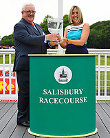 Connections of Power of Darkness receive their trophy for winning The Dee Wilks Against The Odds Confined Novice Stakes (Div 1) during Afternoon Racing at Salisbury Racecourse on 12th June 2018