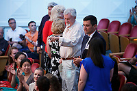 Host families stand for recognition during the opening ceremony of the 11th USA International Harp Competition at Indiana University in Bloomington, Indiana on Wednesday, July 3, 2019. (Photo by James Brosher)