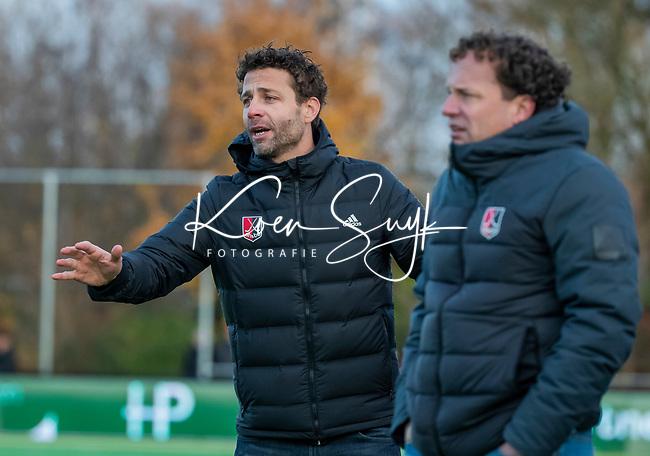 AMSTELVEEN - coach Xanti Freixa (Adam) met assistent-coach Jan Jorn van 't Land (Adam)  tijdens de competitie hoofdklasse hockeywedstrijd heren, Pinoke-Amsterdam (1-1)   COPYRIGHT KOEN SUYK