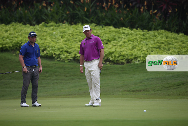 Lee Westwood (ENG) misses his birdie on the 4th watched by Andy Sullivan (ENG) eager to get on with the job during the Final Round of the 2014 Maybank Malaysian Open at the Kuala Lumpur Golf & Country Club, Kuala Lumpur, Malaysia. Picture:  David Lloyd / www.golffile.ie