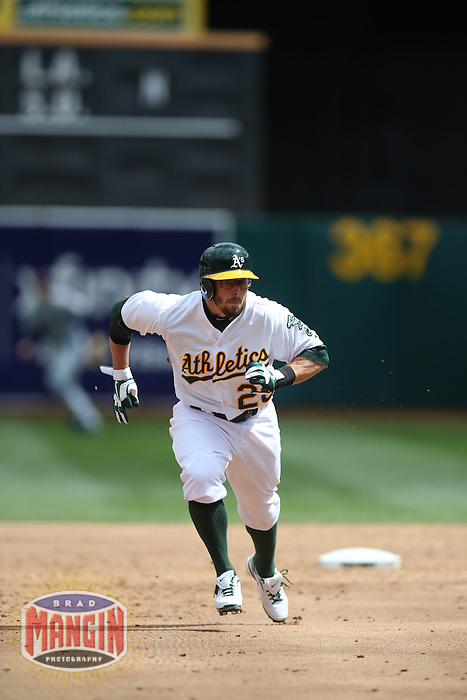 OAKLAND, CA - APRIL 2:  Eric Sogard #28 of the Oakland Athletics runs the bases against the Cleveland Indians during the game at O.co Coliseum on Wednesday, April 2, 2014 in Oakland, California. Photo by Brad Mangin
