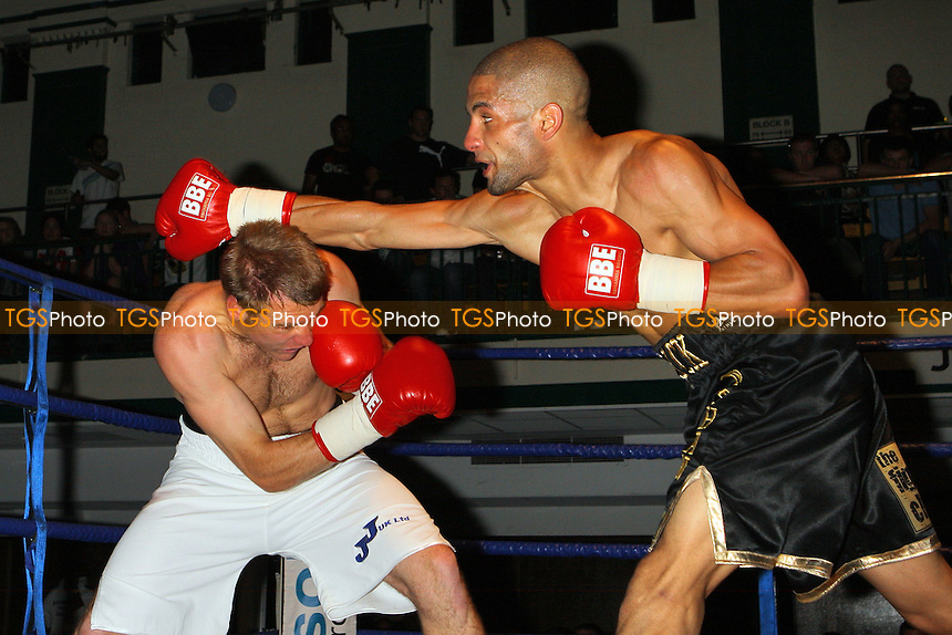 Nathan Graham (black shorts) defeats Scott Woolford in a Light-Middleweight Boxing contest at York Hall, Bethnal Green, promoted by Hard Knocks / Spencer Fearon - 04/06/10 - MANDATORY CREDIT: Gavin Ellis/TGSPHOTO - Self billing applies where appropriate - Tel: 0845 094 6026