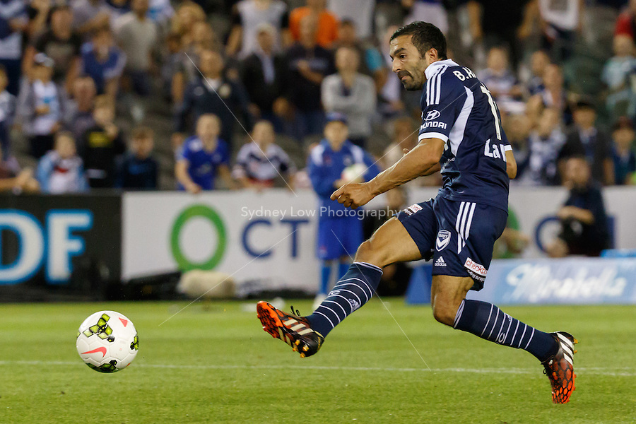 Fahid BEN KHALFALLAH of the Victory kicks the ball in the round seven match between Melbourne Victory and Brisbane Roar in the Australian Hyundai A-League 2014-15 season at Etihad Stadium, Melbourne, Australia.