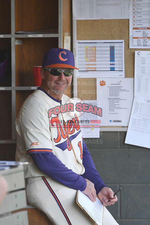 Head coach Monte Lee (18) of the Clemson Tigers waits in the dugout for the start of a game against the Furman Paladins on Tuesday, February 20, 2018, at Doug Kingsmore Stadium in Clemson, South Carolina. Clemson won, 12-4. (Tom Priddy/Four Seam Images)