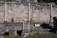 DELPHI, GREECE - APRIL 12 : A front view of the Stoa of the Athenians with the polygonal wall in the background, on April 12, 2007 in the Sanctuary of Apollo, Delphi, Greece. The Stoa of the Athenians was erected circa 479BC after the victory of the Athenians in the naval battle of Salamis. The 3 Ionic columns were part of the Ionic stoa with 7 columns. (Photo by Manuel Cohen)