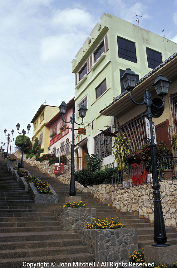 Steep street lined with retored houses and restaurants in the Las Penas historic district on Cerro Santa Ana in Guayaquil, Ecuador