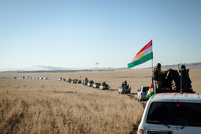 12/11/2015-- Iraq,Sinjar -- Peshmarga forces is heading to tha (Gollat) village after liberating (Fazilia) village which they were trying to control on the first day of liberating Sinjar.