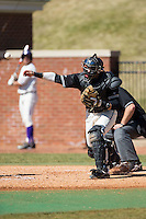 LIU-Brooklyn Blackbirds catcher Vincent Tranchina (4) makes a throw to third base against the High Point Panthers at Willard Stadium on March 8, 2015 in High Point, North Carolina.  The Panthers defeated the Blackbirds 9-0.  (Brian Westerholt/Four Seam Images)