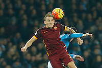 AS Roma's Lucas Digne heads the ball  during the  italian serie a soccer match,between SSC Napoli and AS Roma       at  the San  Paolo   stadium in Naples  Italy ,December 13, 2015