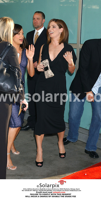 ALL ROUND PICTURES FROM SOLARPIX.COM.*MUST CREDIT SOLARPIX.COM OR DOUBLE FEE WILL BE CHARGED*.The premiere of the Film THE LAKEHOUSE  at the 'Arclight Theater' in Los Angeles, California in the USA on June 13, 2006..This pic:Sandra Bullock with Constance Marie and husband, Jesse James peeking over her shoulder arrives at the premiere.DATE:14.06.06-JOB REF:2489-GLS