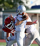 SIOUX FALLS, SD, AUGUST 27:  Tucker Hall #52 from Sioux Falls Lincoln wraps up quarterback Jamin Wurtz #10 from Rapid City Stevens in the first half of their game Saturday night at Howard Wood Field. (Photo by Dave Eggen/Inertia)