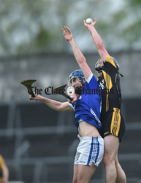 James Enright of Cratloe on action against Gearoid O Connell of Ballyea during their match in Ennis. Photograph by John Kelly.