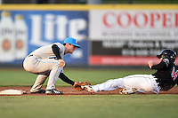 Akron RubberDucks second baseman Joe Wendle (7) tags out Jason Krizan (14) sliding in during a game against the Erie SeaWolves on May 17, 2014 at Jerry Uht Park in Erie, Pennsylvania.  Erie defeated Akron 2-1.  (Mike Janes/Four Seam Images)