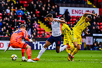 Everton's forward Dominic Calvert-Lewin (9) for England U21's  prods it by Zorya Luhansk's goalkeeper Andriy Lunin (23) for Ukraine U21's during the International Euro U21 Qualification match between England U21 and Ukraine U21 at Bramall Lane, Sheffield, England on 27 March 2018. Photo by Stephen Buckley / PRiME Media Images.
