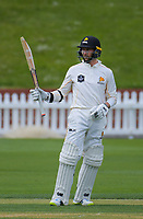 Devon Conway acknowledges applause for his half century on day one of the Plunket Shield cricket match between Wellington Firebirds and Otago Volts at the Basin Reserve in Wellington, New Zealand on Wednesday, 17 October 2018. Photo: Dave Lintott / lintottphoto.co.nz