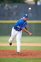 Biloxi Shuckers pitcher Hiram Burgos (26) delivers a pitch during a game against the Birmingham Barons on May 24, 2015 at Joe Davis Stadium in Huntsville, Alabama.  Birmingham defeated Biloxi 6-4 as the Shuckers are playing all games on the road, or neutral sites like their former home in Huntsville, until the teams new stadium is completed in early June.  (Mike Janes/Four Seam Images)