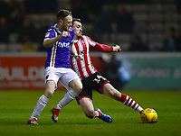 Lincoln City's Harry Toffolo battles with Exeter City's Jake Taylor<br /> <br /> Photographer Andrew Vaughan/CameraSport<br /> <br /> The EFL Sky Bet League Two - Lincoln City v Exeter City - Tuesday 26th February 2019 - Sincil Bank - Lincoln<br /> <br /> World Copyright © 2019 CameraSport. All rights reserved. 43 Linden Ave. Countesthorpe. Leicester. England. LE8 5PG - Tel: +44 (0) 116 277 4147 - admin@camerasport.com - www.camerasport.com