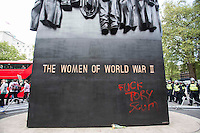 Photographer: Rick Findler<br /> <br /> London, UK. 09.05.15 Graffiti is scrolled onto The Women of World War II monument outside of Downing Street, London this evening during an anti-conservative protest which saw thousands of people take to the streets of the capital. Some protesters tried to push through police walls causing riot police to act, and protesters to light flares.