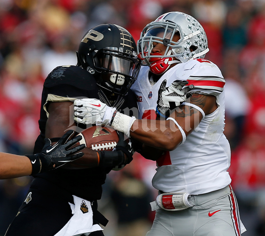 Purdue Boilermakers running back Keith Byars (4) is tackled by Ohio State Buckeyes linebacker Ryan Shazier (2) during Saturday's NCAA Division I football game at Ross-Ade Stadium in West Lafayette, In. on November 2, 2013. (Barbara J. Perenic/The Columbus Dispatch)