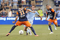 Michael Thomas (88) midfield Sporting KC faces up against.Emanuel Herrera (11) forward Montpellier ..Sporting Kansas City were defeated 3-0 by Montpellier HSC in an international friendly at LIVESTRONG Sporting Park, Kansas City, KS..