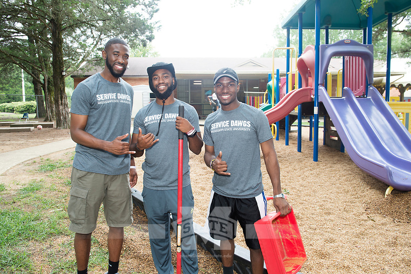 Service Dawgs Day 2017 - student volunteers at the Child Development Center.  Alpha Phi Alpha fraternity brothers join in to help on the playground: Khalil Mcguire (kdm466), CJ Blackmon (scb377), and Charles Reese (cr1080).<br />  (photo by Megan Bean / &copy; Mississippi State University)