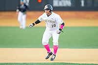 Nate Mondou (10) of the Wake Forest Demon Deacons takes his lead off of second base against the Duke Blue Devils at Wake Forest Baseball Park on April 25, 2014 in Winston-Salem, North Carolina.  The Blue Devils defeated the Demon Deacons 5-2.  (Brian Westerholt/Four Seam Images)