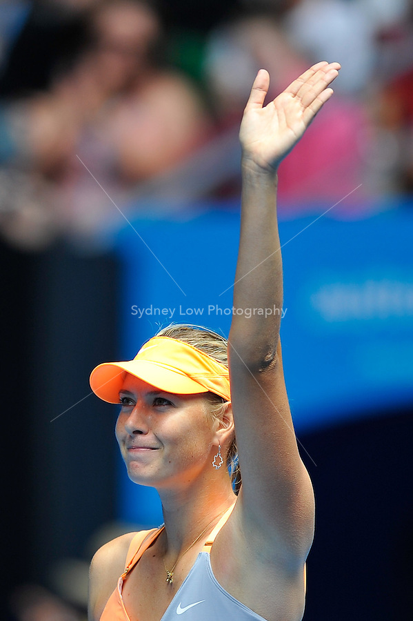 MELBOURNE, 17 JANUARY - Maria Sharapova (RUS) celebrates her win in her first round match against Tamarine Tanasugarn (THA) on day one of the 2011 Australian Open at Melbourne Park, Australia. (Photo Sydney Low / syd-low.com)