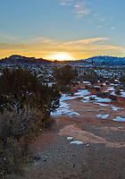 Sunrise gives hope to the frozen sagebrush near the entrance to Arches National Park, Moab, Utah, February 2008.